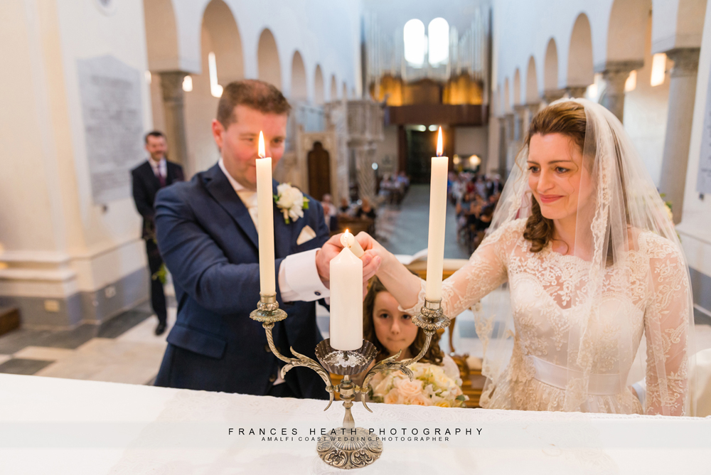 Lighting the candle in Catholic ceremony