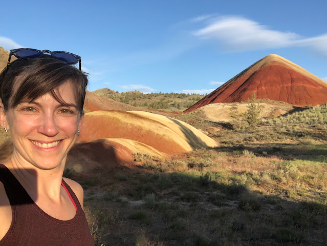 woman in front of colorful rock formations