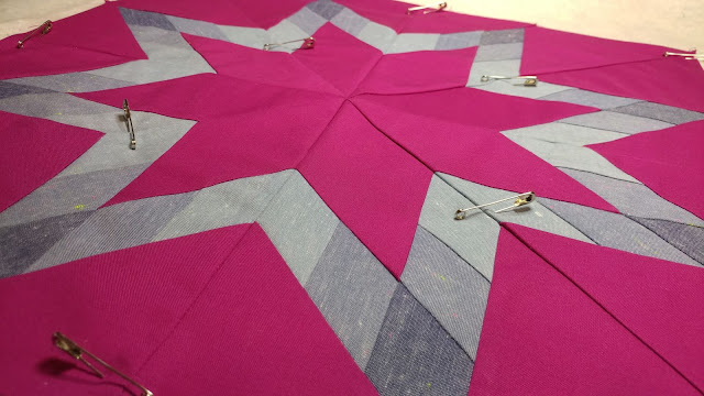 Pin basting a star quilt