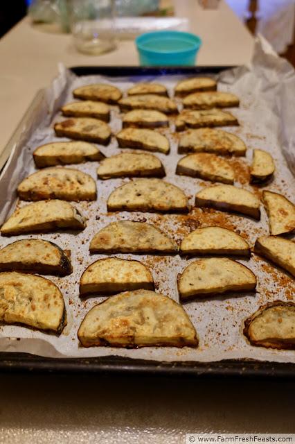 image of a rimmed baking sheet filled with freshly baked crispy eggplant chips