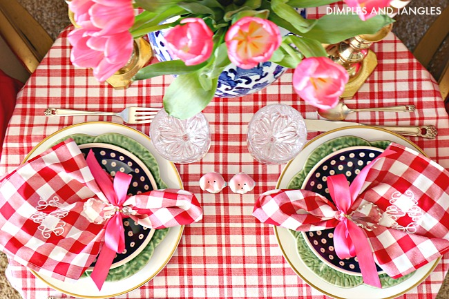 red gingham tablecloth, polish pottery plates, bordallo pinheiro cabbage plate, valentine's day table setting