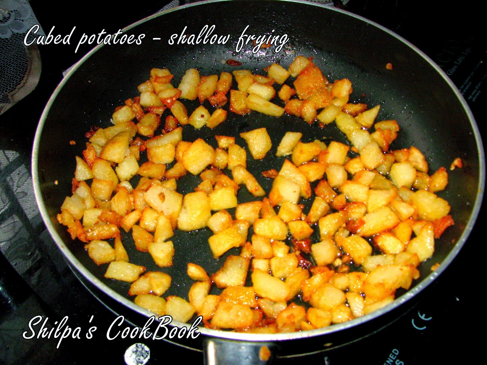 Cook book celebrating my 400th recipe tawa aloo chat take a large pantawa add oil keep on medium heat and shallow fry the boiled potatoes till golden brown forumfinder Choice Image