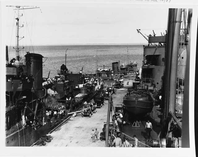 USS Tangier and other ships unloading supplies at Midway Island, 26 December 1941 worldwartwo.filminspector.com