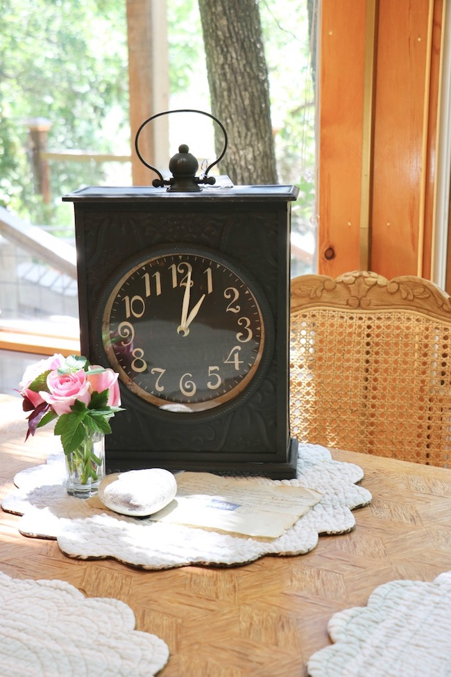 Black French Country Clock Summer Time On Kitchen Table