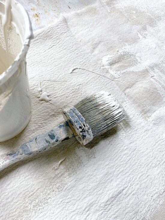 Painting a drop cloth with off white paint