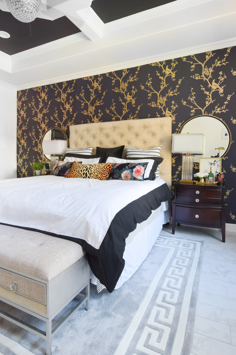 Black and gold wallpaper accent wall in this chic, glam and chinoiserie inspired master bedroom makeover.