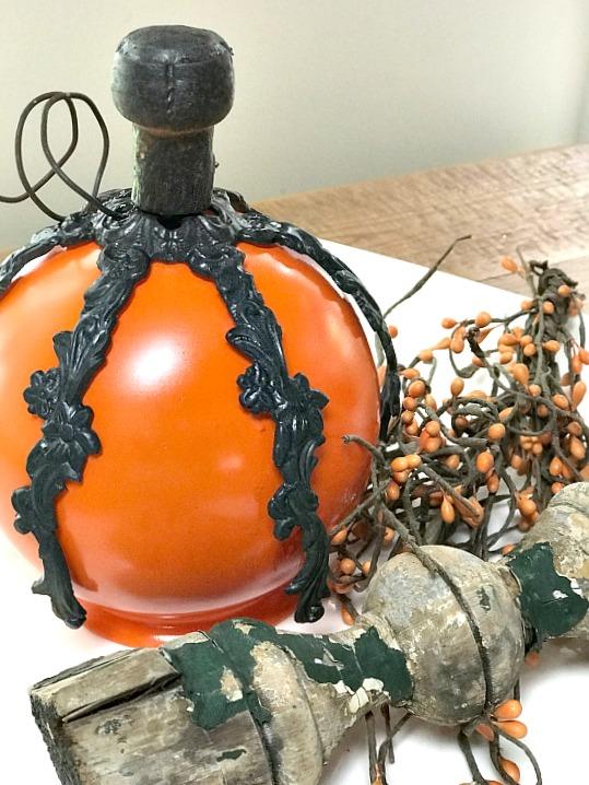 DIY Fall pumpkin made with repurposed lamp parts