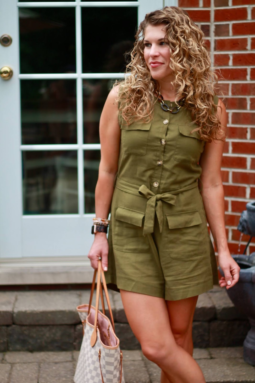 olive romper, LV azure neverfull, leather cognac wedges