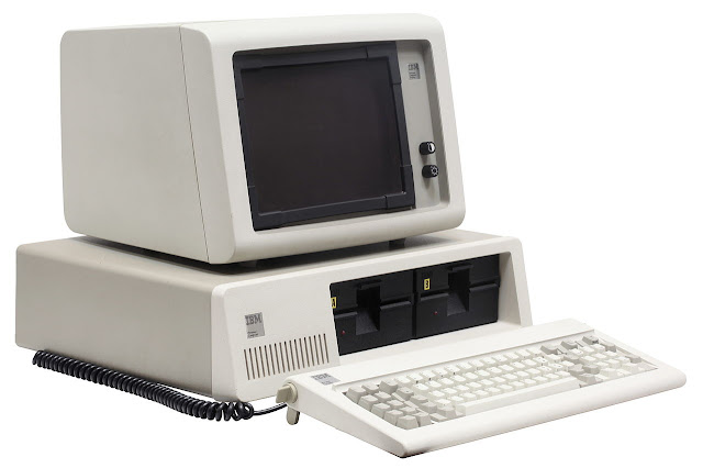 IBM PC with neatly-labelled floppies