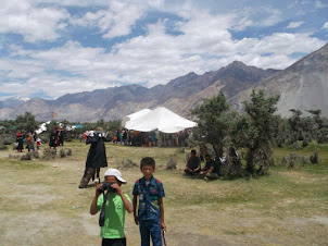 "Kids and adults at the ""Sand Dunes Festival""  at Hunder in Nubra valley."