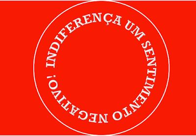 A imagem de fundo vermelho e letras em branco está escrito em forma círculo diz: indiferença um sentimento negativo!  A imagem representando um coração e no centro está escrito: sentimento!