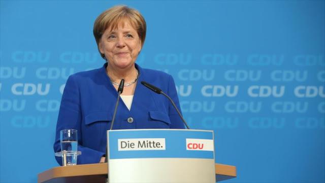 Merkel evita ruptura del gobierno con acuerdo sobre los migrantes
