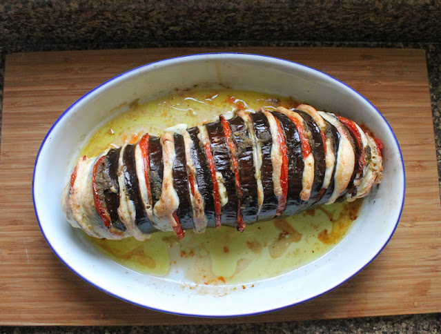Food Lust People Love: Caprese Stuffed Roasted Eggplant is a showstopper of a main course, guaranteed to be loved by vegetarians and omnivores alike. After all, who can resist ripe tomatoes, flavorful basil pesto and melty mozzarella roasted in a hasselback-cut eggplant?