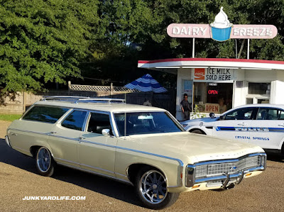 1969 Chevy Kingswood wagon parked in front of Dairy Freeze stand.