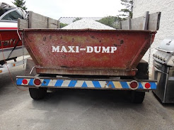 Rear of dump truck with maxi dump written on it