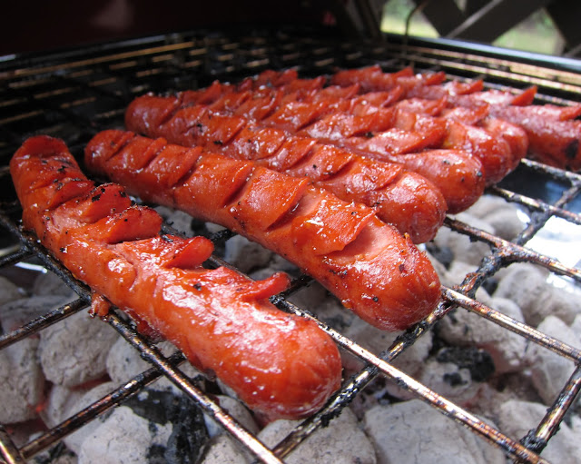 THE BEST Grilled Hot Dogs - hot dogs sliced and marinated before grilling - you will never grill hot dogs any other way! These are seriously amazing!!