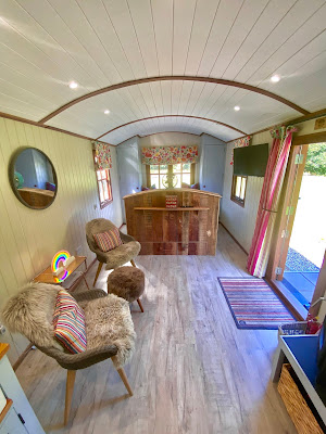 Inside the Shepherd's Hut facing the bed at Parkway Hotel and Spa, Cwmbran