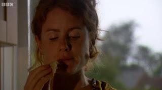 Alys eating freshly cooked bread