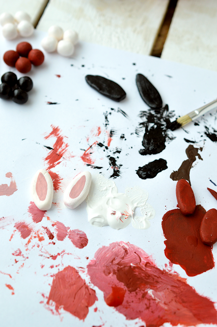 painting bunny ears made from modelling clay