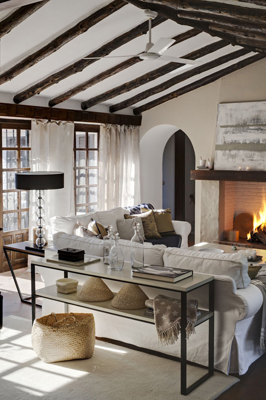 There is definitely a place for a huge fireplace in my dream home like this one. Wooden roof beams are in the plans too.