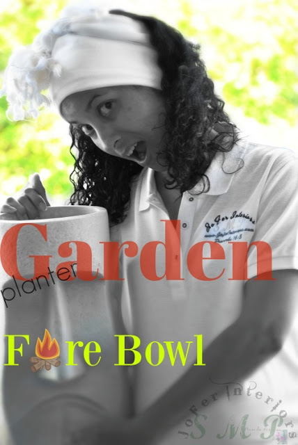 A mans head fiberglass garden planter used as a fire bowl garden decor