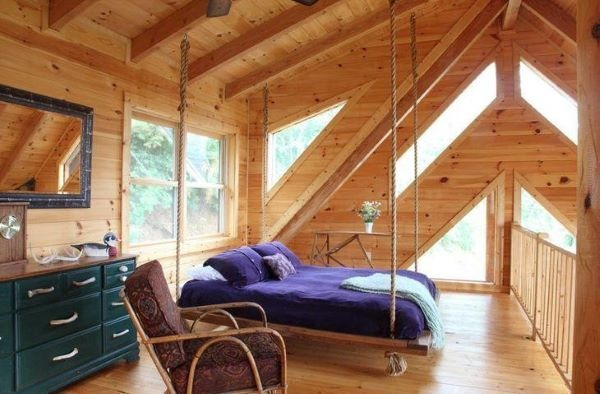 Rope suspended bed in rustic decor
