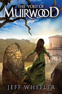 Book cover, 'The Void of Muirwood' by Jeff Wheeler. Image depicts from-the-back view of a woman with long dark hair in a flowing green dress, arms outstretched at her sides, standing between two large rocks with sun faces carved into them. The woman faces a stone building