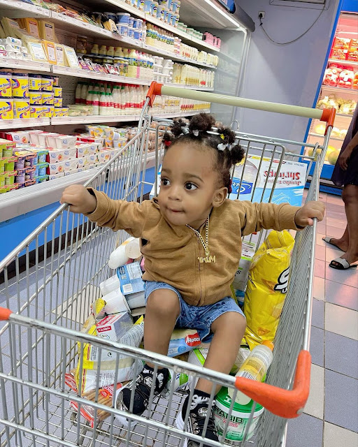 Check out the lovely photos of Regina Daniels son Munir looking like a girl as he goes shopping (Photos)