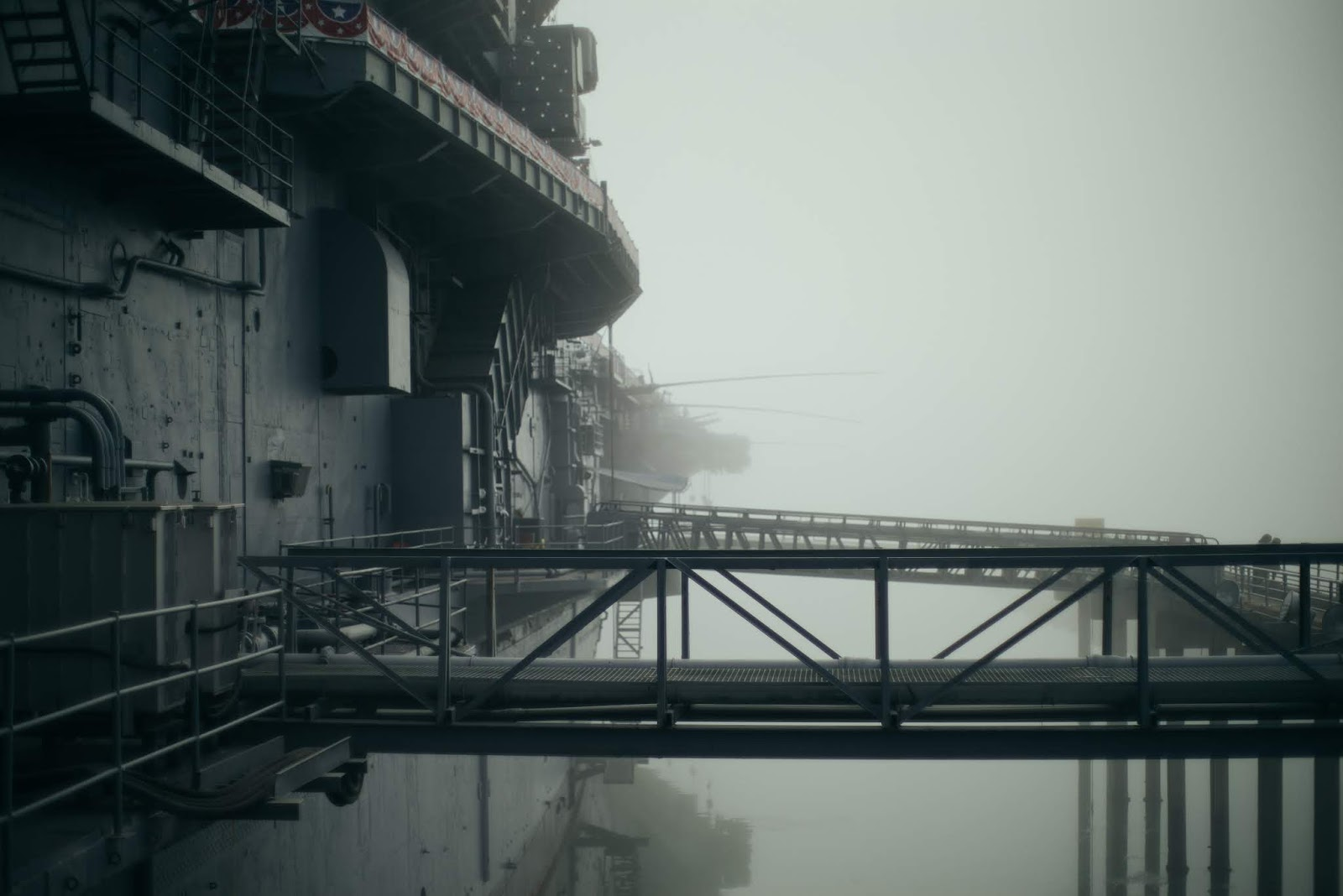 gangway of a ship reaches the dock in fog to illustrate blog post about movie overlord