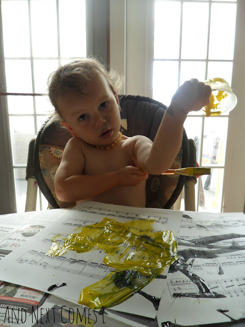 Toddler covered in washable paint