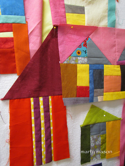improv to the houses.....a quilt block by  marty mason