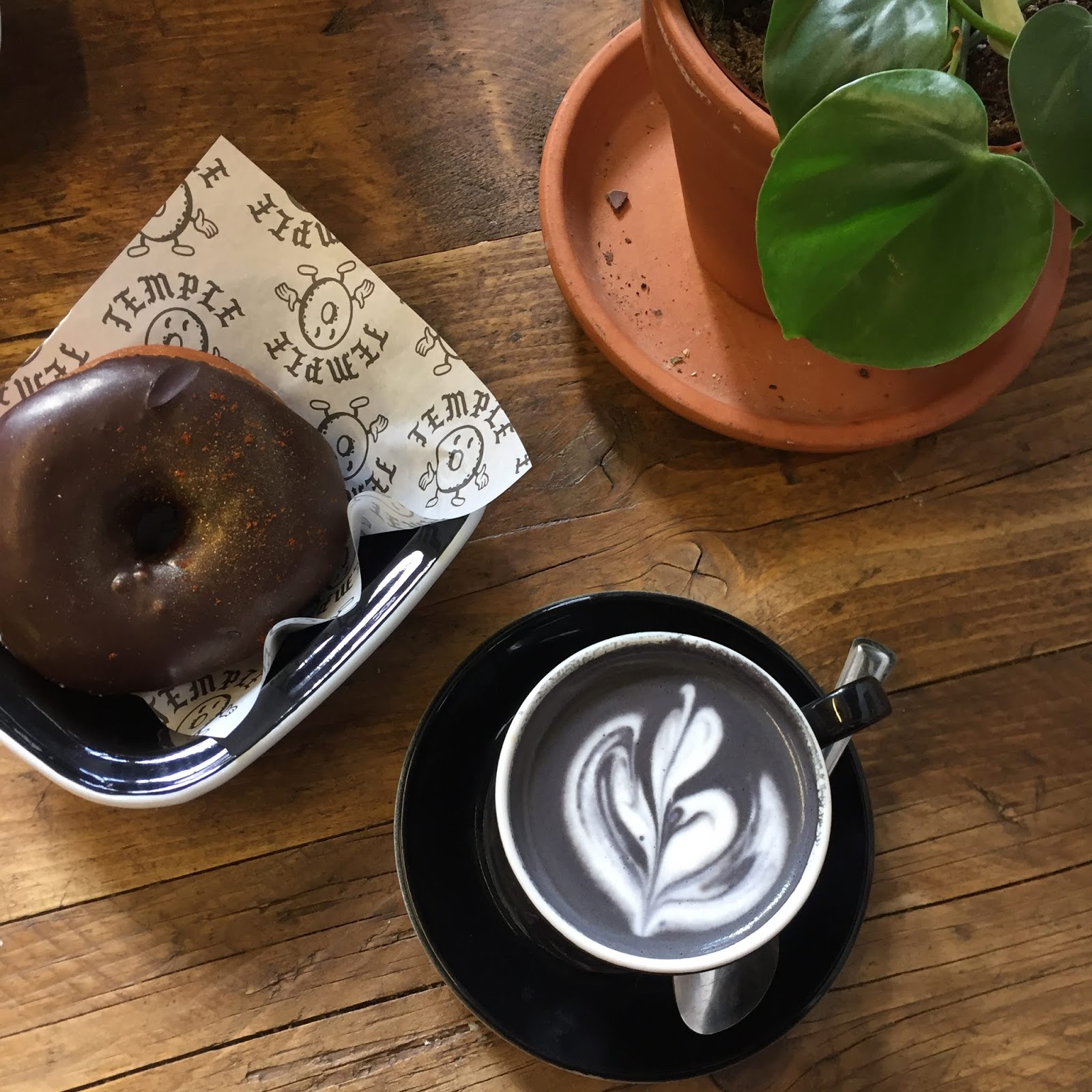 coffee, doughnut and plants at Temple, Leeds