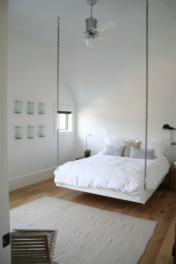 Floating bed in the minimalist room