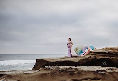 Portrait of mom wearing chicaboo rainbow gown on the beach San Diego Sweet Snappin Photogrpahy