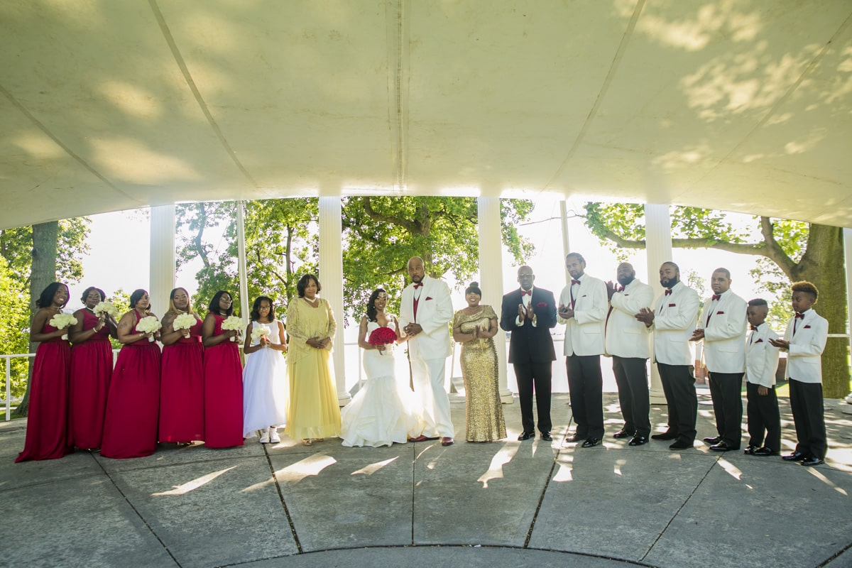 Bride and Groom in company with the wedding crew,exciting moment for all.