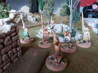 A group of Satyrs creep through the woods