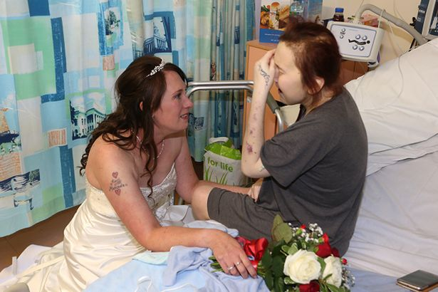Tear-jerking moment bride surprises seriously ill sister in hospital on way to her wedding