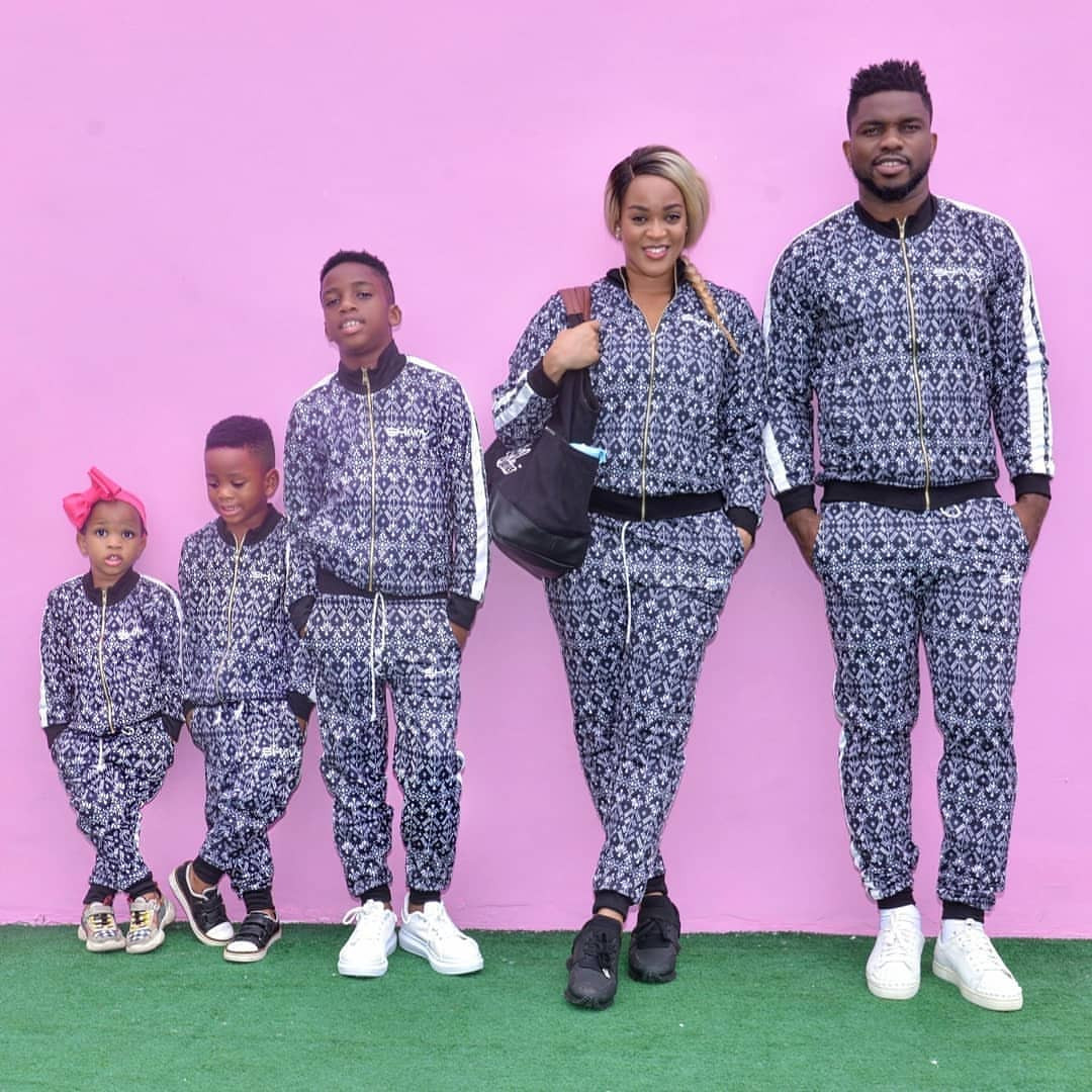Nigerian Couple poses with their kids in matching outfit
