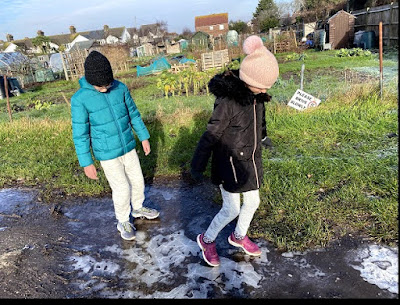 Children playing in frozen puddles
