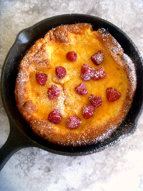 Lemon Raspberry Dutch Baby: A tender, eggy, over-sized pancake laced with bright lemon and topped with tart fresh raspberries.   As wonderful to eat as it is spectacular to look at, no one has to know how easy this is to make! - Slice of Southern