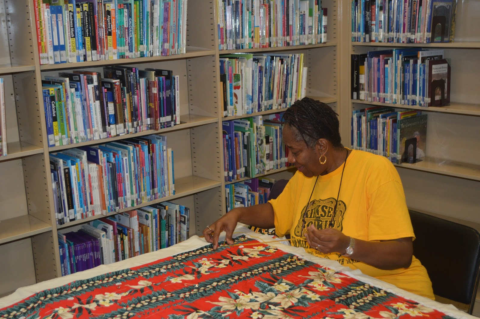 Juliett Watts working on quilt