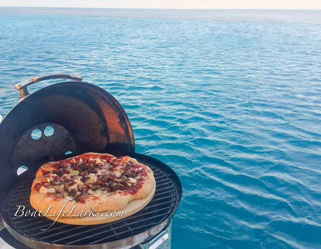 BBQ chicken boat pizza on a Magma Grill - Bahamas