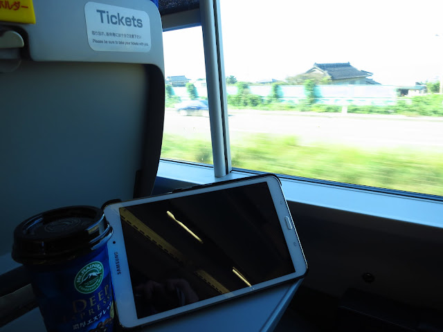 Pocket WiFi while riding train in Japan. Tokyo Consult. TokyoConsult.