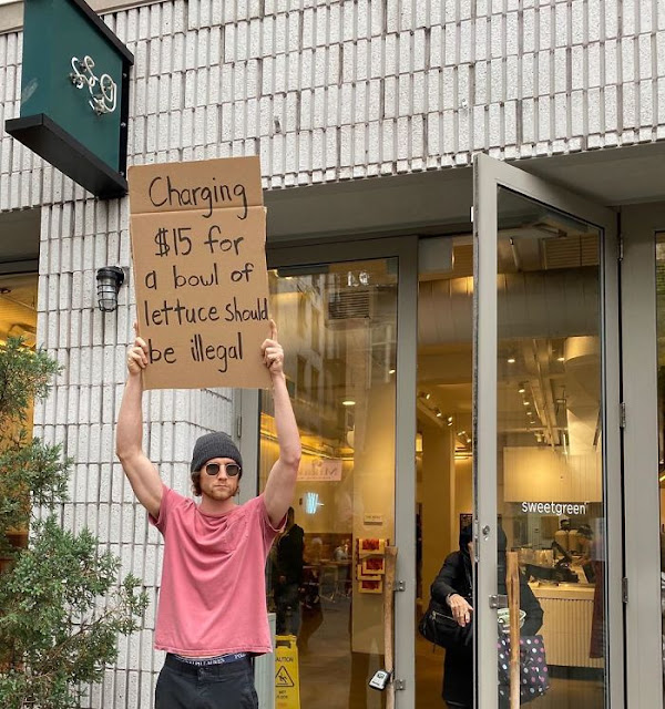 Dude Protests Annoying Everyday Things With Funny Signs