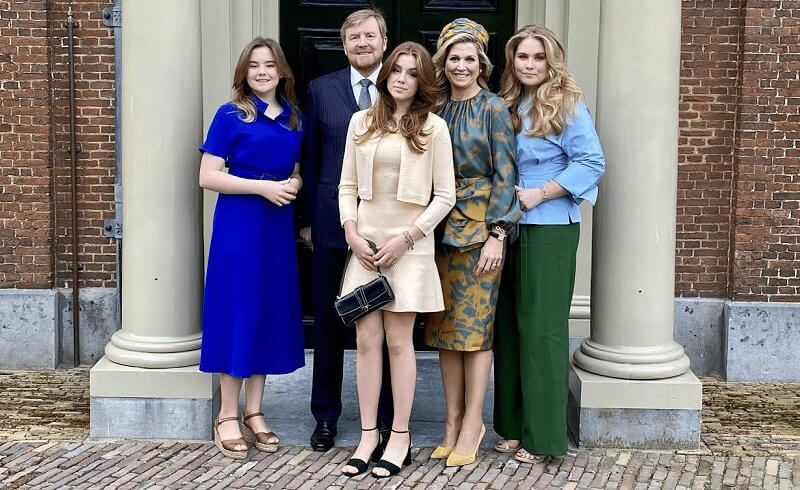 Princess Alexia wore a beige knit cardigan and dress by Maje. Amalia wore a blouse by Natan. Maxima wore a silk skirt and top by Natan