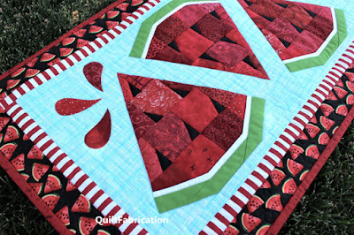 red watermelon slices on an aqua background fabric
