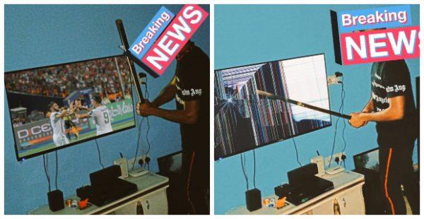 Nigerian man dismantles his TV set as Super eagles lose to Algeria