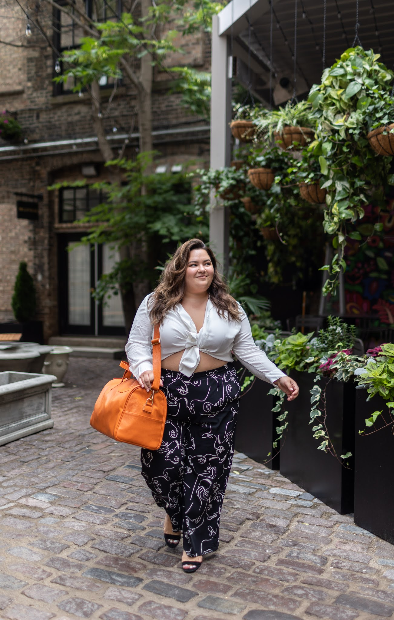 Natalie in the City shares what petite plus size means, how to dress a petite plus size body, and where to shop for petite plus clothing.