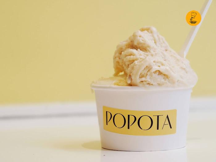 Tarrina de helado de cruasán y maracuya, coco y plátano en Popota, mago merlin mejor helado 2018, helado cruasán Madrid