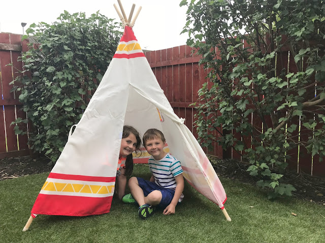 hape child teepee tent set up in the garden